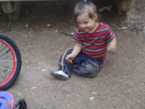 Yirmiyahu, 2, having fun playing in the dirt