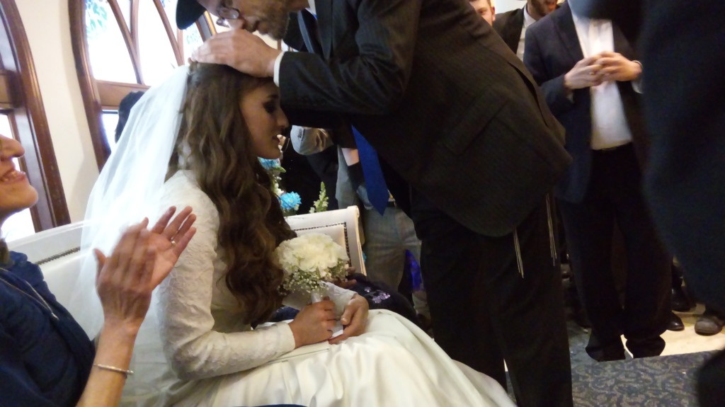 Getting a blessing from her father at bedeken
